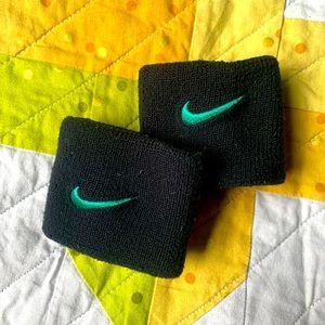 Black and green Nike sweatbands
